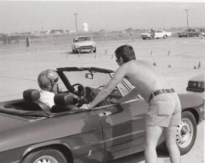 "<span style=""font-size: 10pt; font-family: Arial;\"">Unidentified Alfa driver, probably a Tinker pilot (note helmet) waiting in line while Wally Lee's 240Z heads for the finish line</span>"